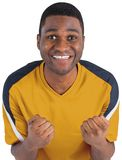 Cheering football fan in yellow jersey Stock Photo