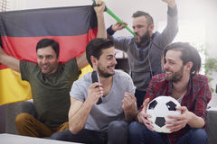 Cheering football fans Royalty Free Stock Images