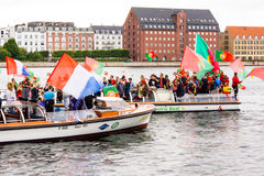 Cheering football supporters on canal boats in Copenhagen Stock Photo