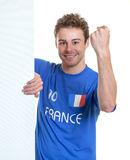 Cheering french soccer fan behind a signboard Royalty Free Stock Images