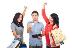 Cheering friends with credit card and shoppings Stock Photography