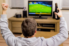 Cheering in front of tv Stock Photography