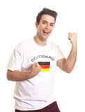 Cheering german sports fan with black hair Stock Image