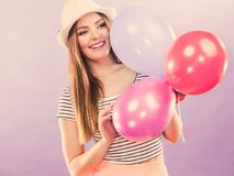 Cheering girl with balloons. Royalty Free Stock Photography