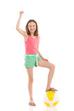 Cheering girl with a beach ball Stock Photos