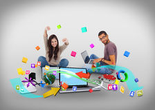 Cheering girl and casual man using laptop with app icons Royalty Free Stock Images