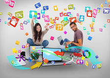 Cheering girl and casual man using laptop with app icons Stock Photos