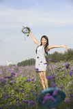 A cheering girl in flower Royalty Free Stock Photos
