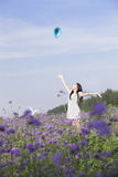 A cheering girl in flower Stock Photo