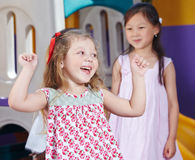 Cheering girl in a kindergarten Royalty Free Stock Photography