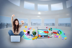 Cheering girl using laptop with app icons Royalty Free Stock Photo