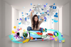 Cheering girl using laptop with app icons Stock Photos