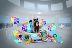 Cheering girl using laptop with app icons Royalty Free Stock Photography