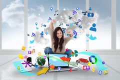 Cheering girl using laptop with app icons Stock Images