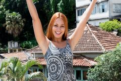 Cheering globetrotter woman with red hair and latin american dre stock images