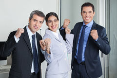 Cheering group of business team. People with clenched fists in the office Stock Photos
