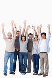 Cheering group of friends raising their arms Stock Photos
