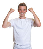 Cheering guy with blond hair Stock Photography