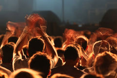 Cheering hands in concert. People clapping and cheering in a concert Royalty Free Stock Photos
