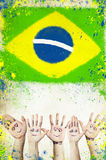 Cheering hands, and flag of Brazil Royalty Free Stock Images
