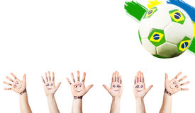 Cheering hands, soccer ball and the Brazil flag Stock Image