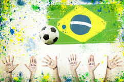 Cheering hands, soccer ball and colors of Brazil Royalty Free Stock Photography