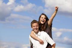 Cheering happy teenage couple stock photography