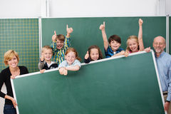 Cheering happy young school children Royalty Free Stock Image