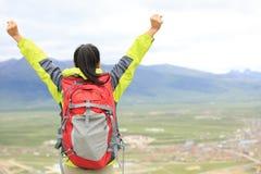 Cheering hiking woman enjoy the beautiful view at mountain peak Royalty Free Stock Image