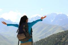 Cheering hiking woman enjoy the beautiful view at mountain peak Royalty Free Stock Images