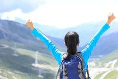 Cheering hiking woman enjoy the beautiful view at mountain peak Stock Photography