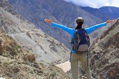 Cheering hiking woman enjoy the beautiful view at mountain peak Royalty Free Stock Photo
