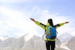 Cheering hiking woman open arms on mountain peak of tibet Stock Photography