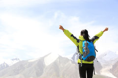 Cheering hiking woman open arms on mountain peak of tibet Stock Images