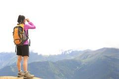Cheering hiking woman open arms on mountain peak Royalty Free Stock Photo