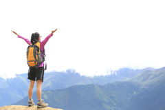 Cheering hiking woman open arms on mountain peak Royalty Free Stock Photos