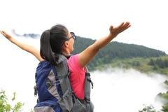 Cheering hiking woman open arms on mountain peak of tibet,china Royalty Free Stock Photo