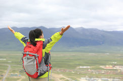 Cheering hiking woman open arms on tibet Royalty Free Stock Images