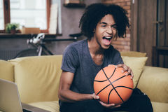 Cheering for his favorite basketball team. Royalty Free Stock Photo
