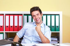 Cheering hispanic guy at office Stock Photo