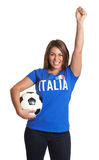 Cheering italian girl. In a blue soccer jersey looking at camera on an isolated white background Royalty Free Stock Image
