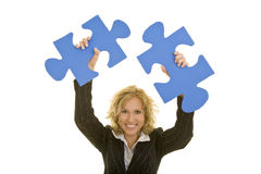 Cheering with jigsaw pieces Royalty Free Stock Photo