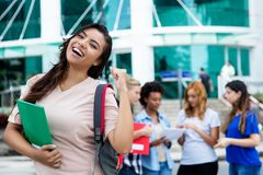 Cheering latin american female student with group of students Stock Images