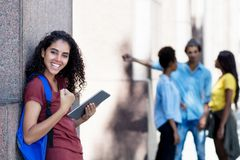 Cheering latin american female student with tablet computer royalty free stock photo