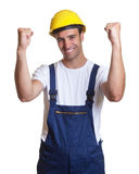 Cheering latin construction worker Royalty Free Stock Photography