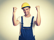 Cheering latin construction worker in vintage retro look Stock Photo