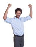 Cheering latin guy with beard looking at camera Royalty Free Stock Photos