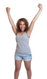 Cheering latin woman in a gray shirt Stock Photos