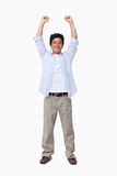 Cheering male with arms up. Against a white background Stock Photo