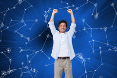 Cheering male with arms up. Composite image of cheering male with arms up Royalty Free Stock Photo